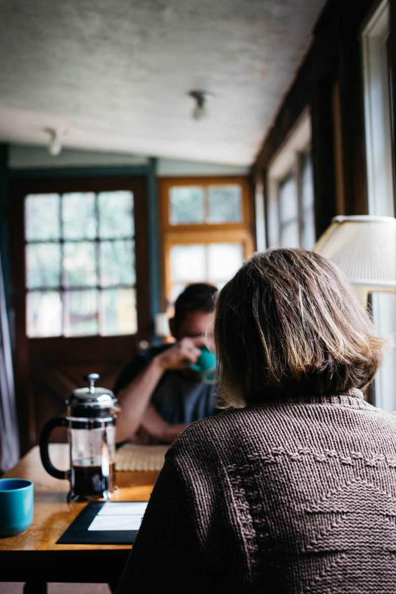 Man and woman at table, Photo by Rachael Gorjestani on Unsplash