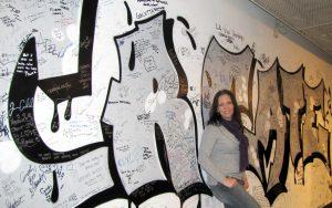 "Elizabeth in front of ""Create"" mural"
