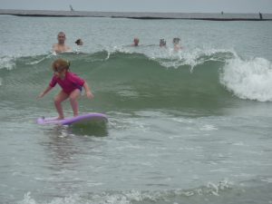 Lisa's daughter surfing