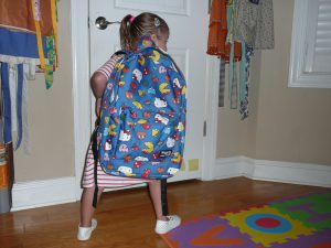 LIsa's daughter with a huge backpack