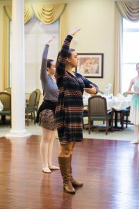 Kathryn at the retirement home doing a demonstration of the ballet arm positions alongside a student