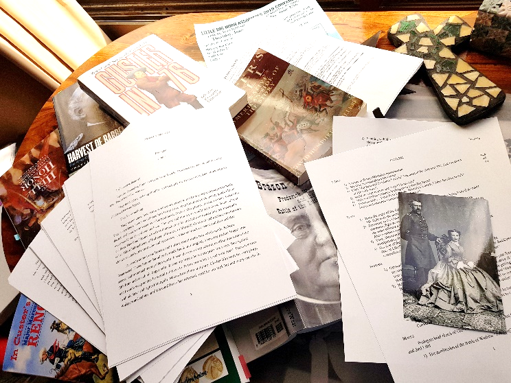 My writing desk on most days: a mess of newly written chapters and outlines, too many books about General Custer and Libbie, and lots of post-it notes. Marie Kondo, stay far, far away…